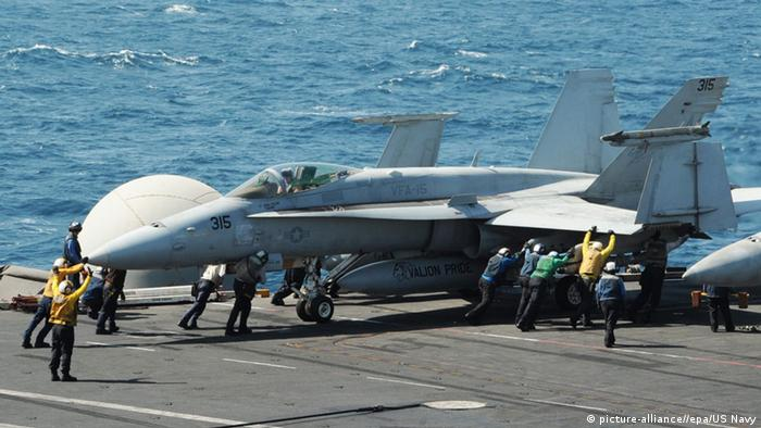 epa04345855 A handout picture provided by the US Navy shows sailors guiding an F/A-18C Hornet assigned to the Valions of Strike Fighter Squadron (VFA) 15 on the flight deck of the US aircraft carrier USS George H.W. Bush (CVN 77), in the Arabian Gulf, 08 August 2014. EPA/Lorelei Vander Griend/US NAVY/HANDOUT HANDOUT EDITORIAL USE ONLY