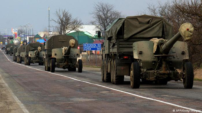 Unmarked military trucks belonging to Russian forces pull cannons as they move as a convoy towards the border area between Crimea and the Kherson region of Ukraine (photo: VASILY MAXIMOV/AFP/Getty Images)