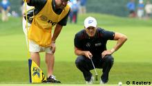 LOUISVILLE, KY - AUGUST 08: Martin Kaymer of Germany and caddie Craig Connelly line up a putt on the fourth green during the second round of the 96th PGA Championship at Valhalla Golf Club on August 8, 2014 in Louisville, Kentucky. (Photo by Andrew Redington/Getty Images)