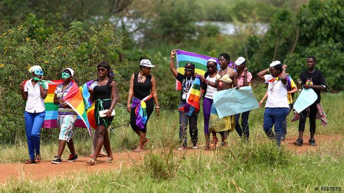 Protesters march in a gay rights parade in Uganda
