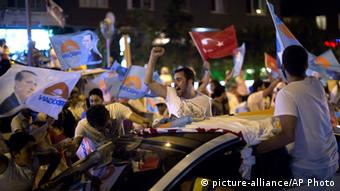 Supporters in Istanbul cheer for Erdogan