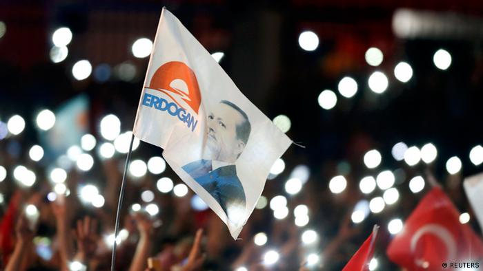A flag with the picture of Turkey's Prime Minister Tayyip Erdogan is seen during celebrations of his election victory in front of the party headquarters in Ankara August 10, 2014. Erdogan secured his place in history as Turkey's first directly elected president on Sunday, sweeping more than half the vote in a result his opponents fear heralds an increasingly authoritarian state. (photo: REUTERS/Umit Bektas)