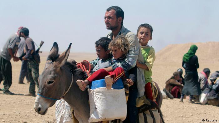 Flüchtlingsfamilien am Sindschar-Gebirge. Foto: REUTERS/Ari Jalal