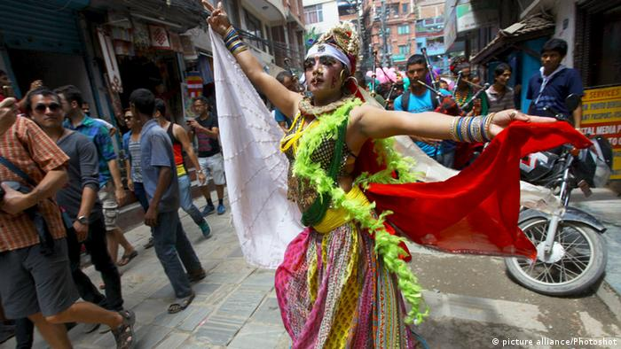 A woman dancing at the Gaijatra festival