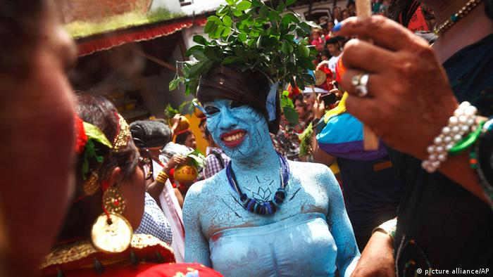 A woman who had painted her face and body blue for the festival.