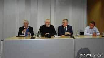 Вольфґанґ Ґерке (другий зліва) на прес-конференції Петра Симоненка (другий справа) в Берліні 12 серпня