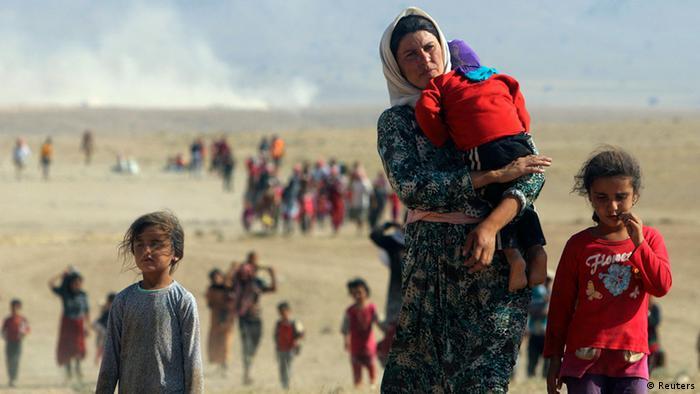 Езиды спасаются бегством от боевиков ИГ
