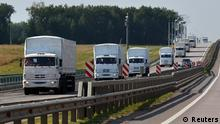 A Russian convoy of trucks carrying humanitarian aid for Ukraine drives along a road near the city of Yelets August 12, 2014. The convoy carrying tonnes of humanitarian aid left on Tuesday for eastern Ukraine, where government forces are closing in on pro-Russian rebels, but Kiev said it would not allow the vehicles to cross onto its territory. Ukrainian presidential aide Valery Chaly told journalists the cargo will be reloaded onto other transport vehicles at the border by the Red Cross. Russia said it would transfer the convoy to the aegis of the International Committee of the Red Cross, but made no reference to the demand the goods be reloaded. The European Union said the aid would have to be verified. REUTERS/Nikita Paukov (RUSSIA - Tags: POLITICS CIVIL UNREST CONFLICT TPX IMAGES OF THE DAY)