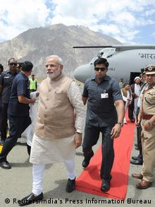 India's Prime Minister Narendra Modi (front L) arrives at the airport in Kargil August 12, 2014 (Photo: REUTERS/India's Press Information Bureau/Handout via Reuters)