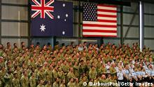 DARWIN, AUSTRALIA - NOVEMBER 17: Troops look on as U.S. President Barack Obama and Australian Prime Minister Julia Gillard (unseen) address them at RAAF Darwin on the second day of his 2-day visit to Australia, on November 17, 2011 in Darwin, Australia. The President today laid a wreath at the USS Peary Memorial, before visiting the RAAF base, where US Army Air Force units were established during World War II. (Photo by Scott Barbour - Pool/Getty Images)
