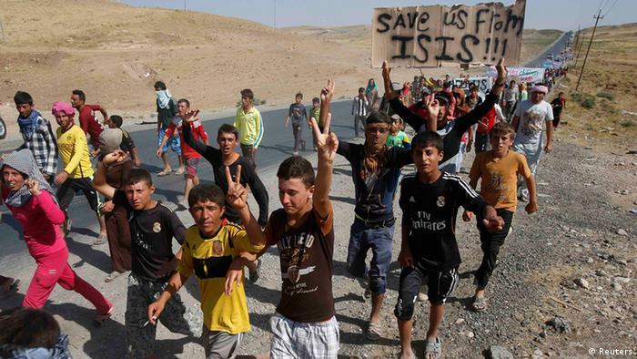 Flüchtlinge IM Nordirak fordern Schutz vor IS-Milizen. Foto: REUTERS/Youssef Boudlal