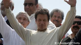 Pakistan cricketer-turned-politician Imran Khan gestures as he leads a protest march from Lahore to Islamabad against the government, in Lahore on August 14, 2014 (Photo: ASIF HASSAN/AFP/Getty Images)