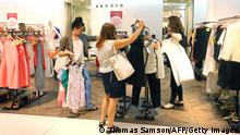 Customers inspect clothes in a department store on June 27, 2012, in Paris, during the official start of the 2012 summer sales. The sales period will take place nationwide until July 31, 2012. AFP PHOTO / THOMAS SAMSON (Photo credit should read THOMAS SAMSON/AFP/GettyImages)