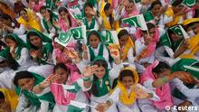 Female students wave Pakistan's national flag at a ceremony to celebrate the country's Independence Day at the mausoleum of Muhammad Ali Jinnah in Karachi August 14, 2014. Pakistan gained independence from British rule in 1947. Jinnah is generally regarded in Pakistan as the Father of the Nation. REUTERS/Athar Hussain (PAKISTAN - Tags: EDUCATION ANNIVERSARY)