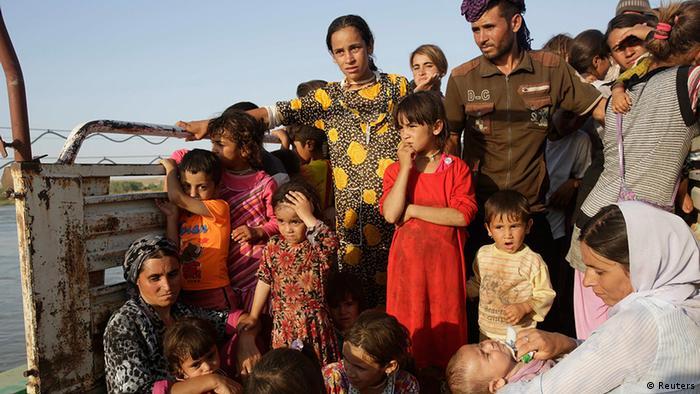 Irak Jesiden auf der Flucht auf Lastwagen
