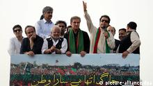 epa04354333 Imran Khan (2-R), a Cricketer-turned politician and head of oppostion party Pakistan Tehrik-e-Insaf that is also ruling militancy-hit Khyber-Pakhtunkhwa province, line up to welcome their leader along the G.T road, in Gujranwala, Pakistan, 15 August 2014. Thousands of anti-government protesters in Pakistan began a march on Islamabad on 14 August amid fears that a prolonged confrontation might lead to a military coup a year after the country's first democratic transfer of power. Cricketer-turned-politician Imran Khan and Pakistani-Canadian cleric Tahirul Qadri were leading the separate protest rallies to topple the government of Prime Minister Nawaz Sharif. EPA/MUHAMMAD OWAIS