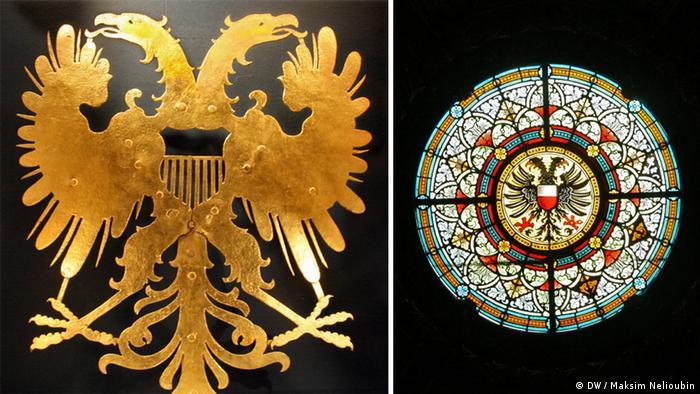 Имперский орел и мозаичное окно в ратуше