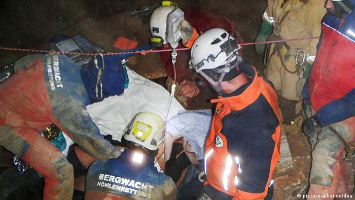 Austrian rescue workers treat a cave researcher rescued in the Austrian Alps