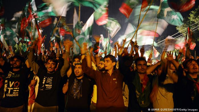 Pakistani supporters of cricketer-turned-politician Imran Khan wave their party flags as they gather during a protest march against the country's Pakistan Muslim League-Nawaz-led government in Islamabad on August 16, 2014 (Photo: AAMIR QURESHI/AFP/Getty Images)