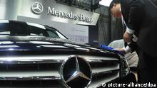 --FILE--An employee cleans a Mercedes-Benz car during an automobile exhibition in Shanghai, China, 19 August 2012. German car maker Daimler AGs luxury brand division Mercedes-Benz has been found guilty of manipulating prices for after-sales services in China, Xinhua reported, citing authorities in Jiangsu province. The Jiangsu Province Price Bureau, which launched its investigation last month, found evidence of anti-competitive practices after raiding Mercedes-Benz dealerships in the eastern coastal province as well as an office in neighbouring Shanghai, Xinhua said in its report on Sunday. On August 5, Mercedes-Benz said it was assisting the authorities in their investigation. A spokesman for the German brand was not immediately available to comment on the Xinhua report.