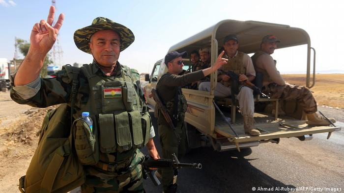 Peshmerga fighter makes a peace sign with his hand near Mosul Dam