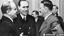 Soviet Foreign minister Vyacheslav Molotov confering with nazi dictator Adolf Hitler. Molotov was the main Soviet signatory of the Nazi-Soviet non-aggression pact of 1939.