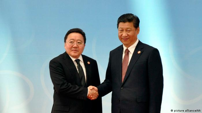 Mongolian President Tsakhia Elbegdorj (L) is greeted by Chinese President Xi Jinping (R) before the opening ceremony at the fourth Conference on Interaction and Confidence Building Measures in Asia (CICA) summit in Shanghai, China, on May 21, 2014. (Photo: Ali Ihsan Cam / Anadolu Agency)