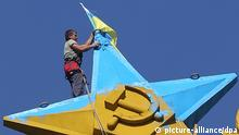 Ukrainian flag put up on Seven Sisters skyscraper in Moscow ITAR-TASS: MOSCOW, RUSSIA. AUGUST 20, 2014. A Ukrainian flag being taken down from the top of the Kotelnicheskaya Embankment building. (Photo ITAR-TASS/ Vyacheslav Prokofyev)