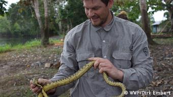 Photo: man with snake (Photo: WWF/Dirk Embert)