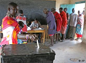 A Maasai woman cast her ballot, Monday, Nov. 21, 2005 near Kajiado, some 100 kilometers south of the capital Nairobi during the referendum on a draft constitution .Thousands of Kenyans lined up to vote Monday in a referendum on a draft constitution that spells out how East Africa's largest economy will be run and its resources shared.(AP Photo/Karel Prinsloo)