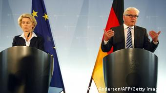 German Defense Minister Ursula von der Leyen and German Foreign Minister Frank-Walter Steinmeier give a press conference on August 20, 2014 in Berlin, announcing that Germany is ready to send arms to help Iraqi Kurds