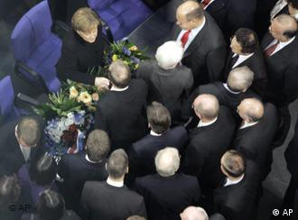 Merkel's husband was noticeably absent from the sea of well-wishers