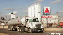 LEMONT, IL - MARCH 8: Tanker trucks load up with fuel at a termial attached to a Citgo oil refinery March 8, 2005 in Lemont, Illinois. Gasoline prices nationwide have climbed in the past two weeks and are expected to remain above two dollars per gallon throughout the summer months. (Photo by Scott Olson/Getty Images)