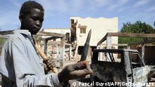 Kind mit Kugel aus einer Maschinenpistole in Douentza (Mali)