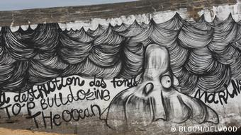 French street artist Delwood's finished work on a Biarritz beach, Copyright: BLOOM/DELWOOD