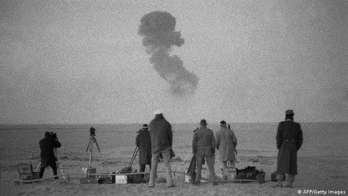 Officials watching a French nuclear test in the Algerian desert