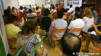 Activists meet in a community center