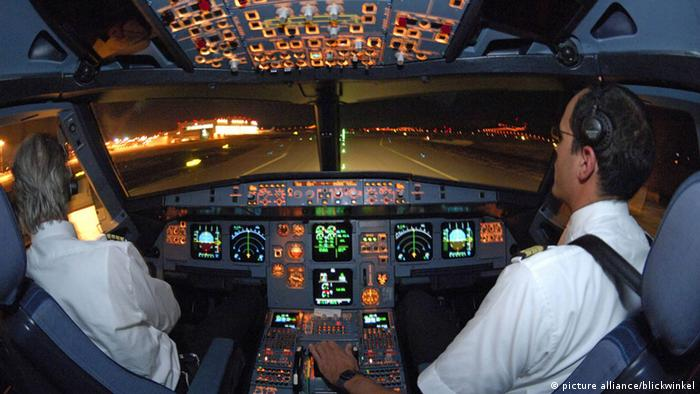 Pilots in cockpit of Airbus 321 after landing at night