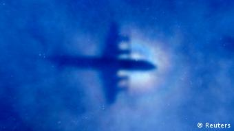The shadow of a Royal New Zealand Air Force (RNZAF) P3 Orion maritime search aircraft can be seen on low-level clouds as it flies over the southern Indian Ocean looking for missing Malaysian Airlines flight MH370