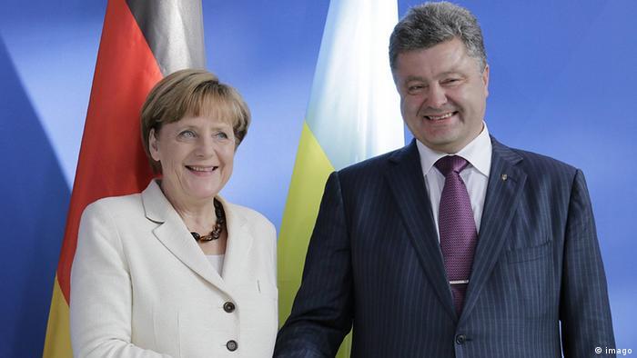 Petro Poroschenko with Angela Merkel in Berlin