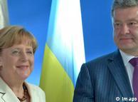Деликатный визит: с чем Меркель летит в Киев?