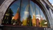 The walls and towers of the Kremlin are reflected in a window of a closed McDonald's restaurant, one of four temporarily closed by the state food safety watchdog, in Moscow, August 21, 2014. Russia ordered the temporary closure of four McDonald's restaurants in Moscow on Wednesday, a decision it said was over sanitary violations but which comes against a backdrop of worsening U.S.-Russian ties over Ukraine. REUTERS/Maxim Zmeyev (RUSSIA - Tags: BUSINESS FOOD POLITICS CITYSCAPE TPX IMAGES OF THE DAY)