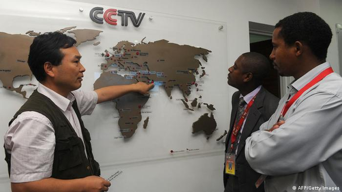The managing editor of China Central Television (CCTV) Africa Pang Xinhua (L) talks to local journalists in Nairobi