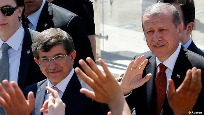 Davutoglu, left, and Erdogan, right, at a meeting on August 22 in Ankara.