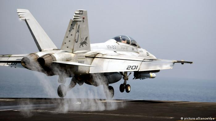An F-18 Hornet takes off from the USS George H.W. Bush