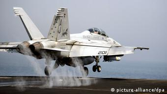 US Jet takes off from aircraft carrier USS George H.W. Bush on a bombing mission against IS - blowback from the US expedition to Iraq that began in 2003