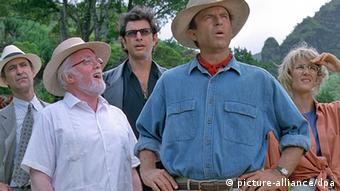 Film still from Jurassic Park with John Hammond (Richard Attenborough) surrounded by his guests. (Photo: Universal Pictures)