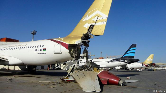 damaged airplanes at tripoli airport