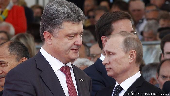 Петро Порошенко й Володимир Путін у Нормандії, червень 2014 року