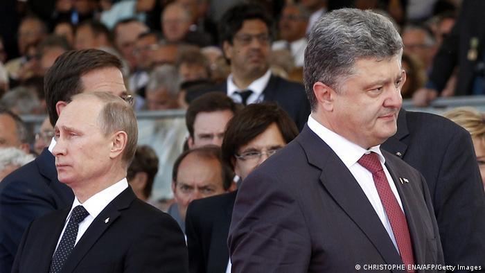 Владимир Путин и Петр Порошенко 6 июля 2014 года в Нормандии